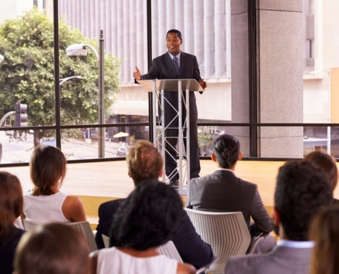 black-businessman-presenting-business-seminar-to--1080-web
